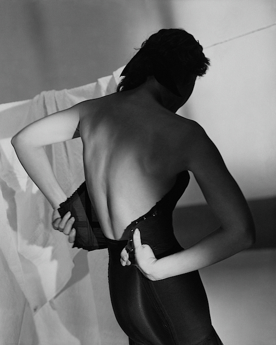 A Model Fastening Her Brassiere Photograph by Horst P. Horst