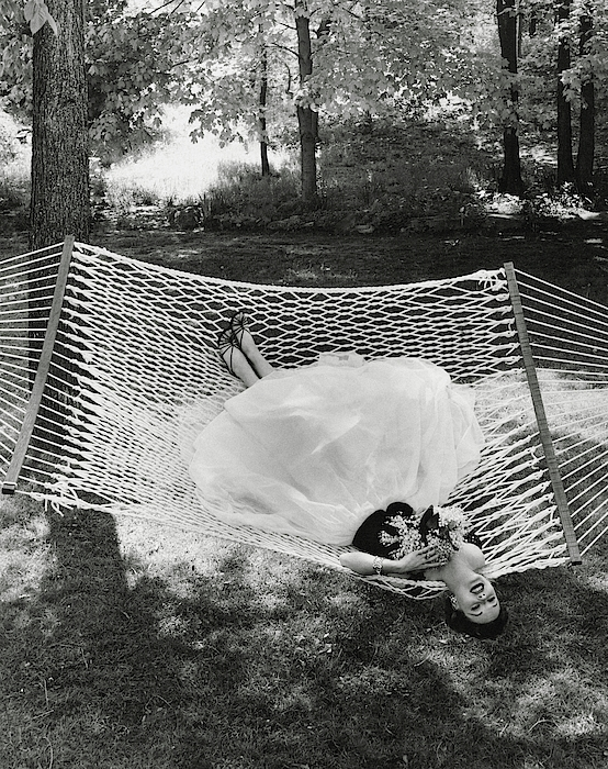 A Model Lying On A Hammock Photograph by Gene Moore