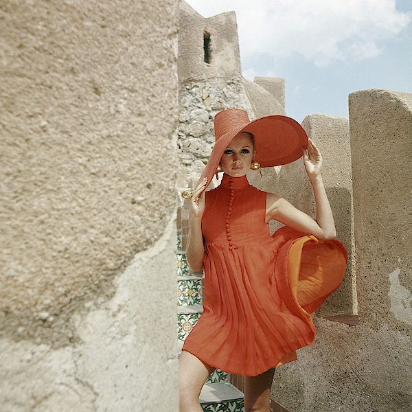 A Model Wearing A Orange Dress Photograph by Henry Clarke