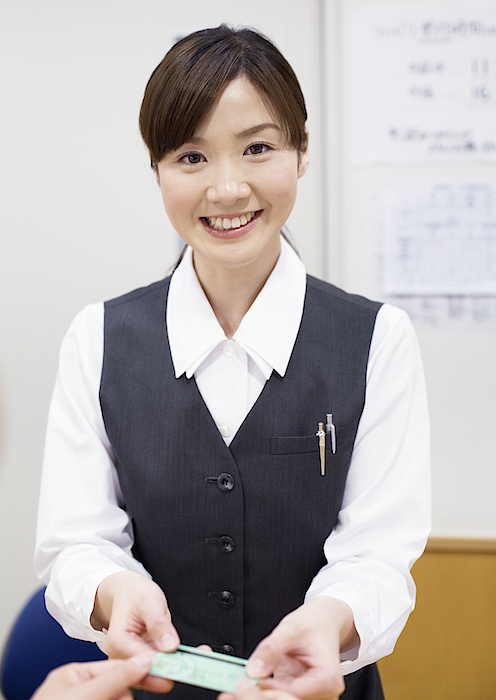 A Smiling Receptionist Photograph by Imagenavi