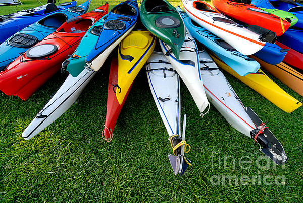 A Lot Photograph - A Stack Of Kayaks by Amy Cicconi
