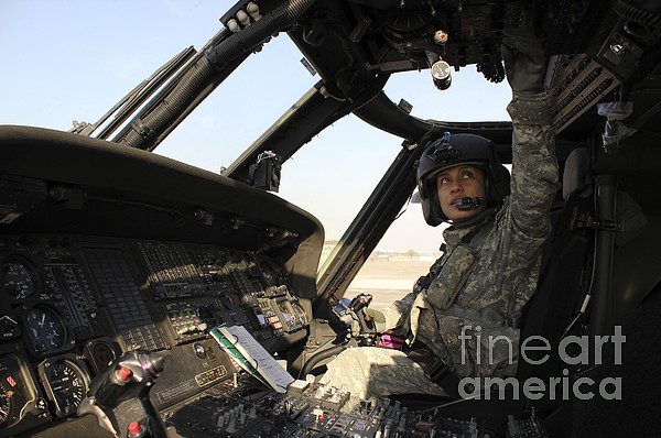 Flight Operations Photograph - A Uh-60 Black Hawk Helicopter by Stocktrek Images