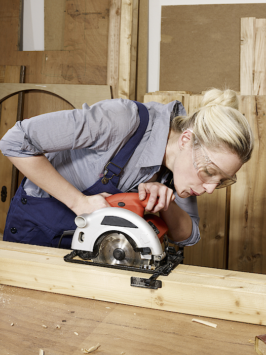 A Woman Sawing Wood Photograph by Carl Smith