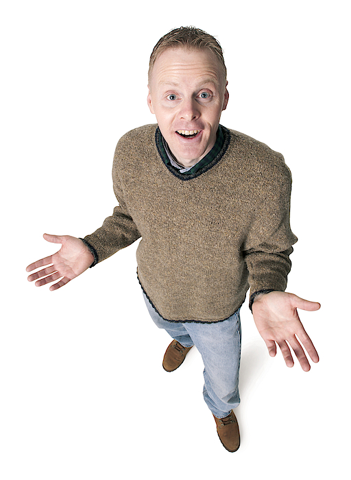 Adult Caucasian Man Dressed In Jeans And Green Sweater Gestures With His Hands Shrugs His Shoulders Photograph by Photodisc