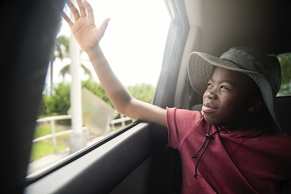 African-american Boy On The Back Seat Of A Car. Photograph by Martinedoucet