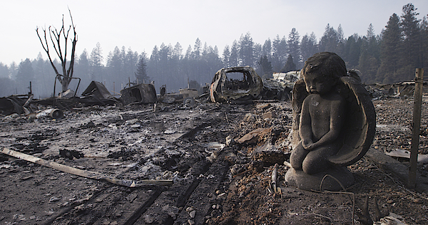 After The Fire Destroyed Everything, A Stone Sculpture Of An Angel Endures, Watching Over The Ash, Rubble, And Wrecked Vehicle In The Neighborhood Photograph by Justin Lewis