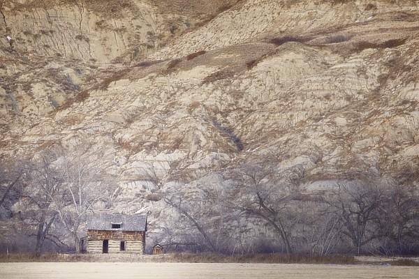 Alberta Photograph - An Abandoned Farmhouse At The Base by Roberta Murray
