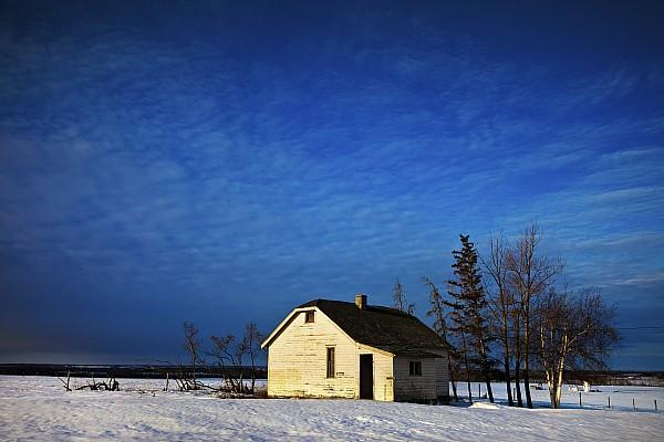 Snow Photograph - An Abandoned Homestead On A Snow by Steve Nagy