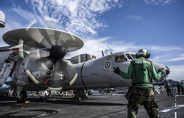An Aircraft Director Directs An E-2c Hawkeye Aboard Uss George Washington. Photograph by Stocktrek Images