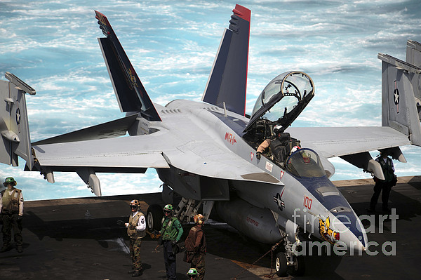 Military Photograph - An Fa-18f Super Hornet Sits by Stocktrek Images