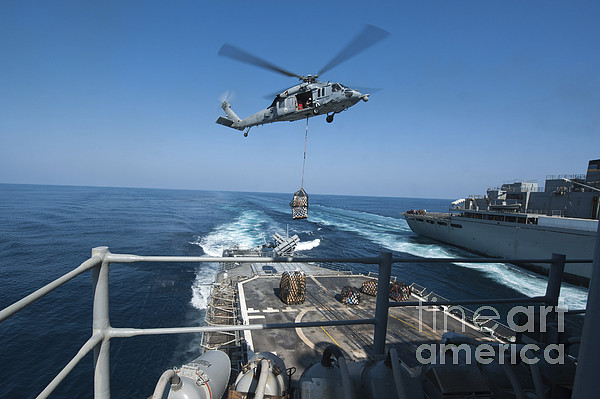 Military Photograph - An Mh-60s Sea Hawk Brings Pallets by Stocktrek Images