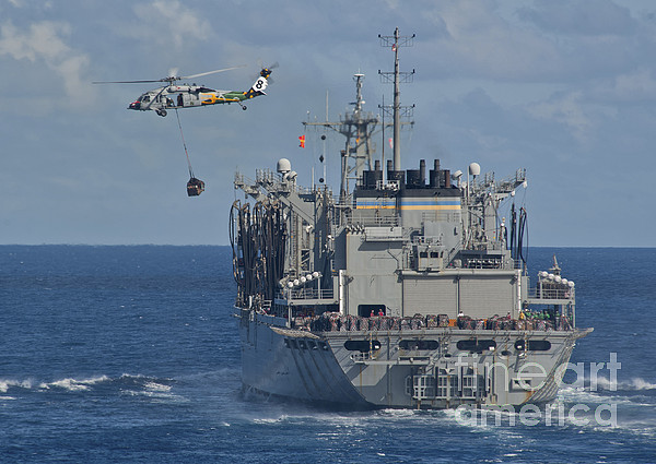 Military Photograph - An Mh-60s Sea Hawk Conducts A Vertical by Stocktrek Images