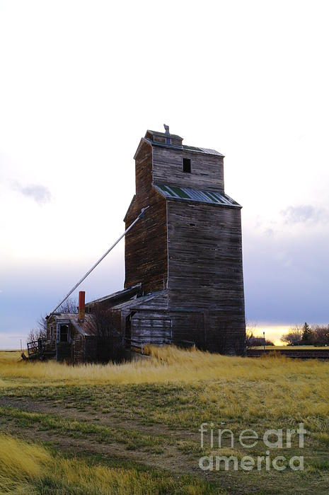 Grain Elevators Photograph - An Old Grain Elevator Off Highway Two In Montana by Jeff Swan