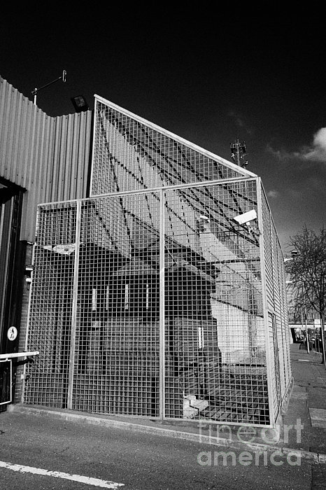 North Photograph - anti rpg cage surrounding observation sanger at North Queen Street PSNI police station Belfast North by Joe Fox
