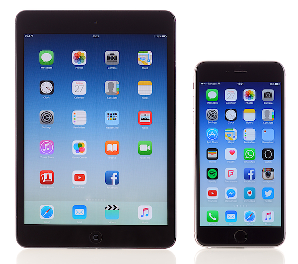 Apple Ipad Mini And Iphone 6 Plus On White Background Photograph by Hocus-focus