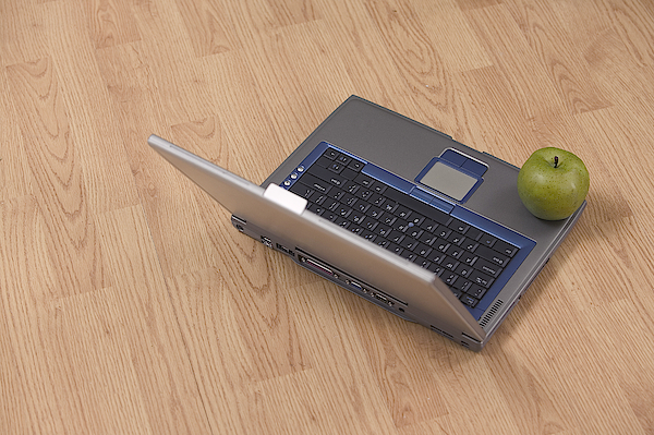 Apple On Laptop Photograph by Comstock Images