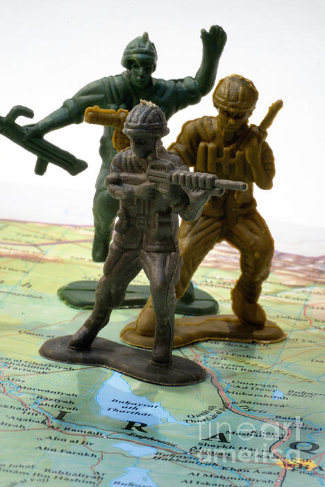 Aggression Photograph - Armed Toy Soliders On Iraq Map by Amy Cicconi