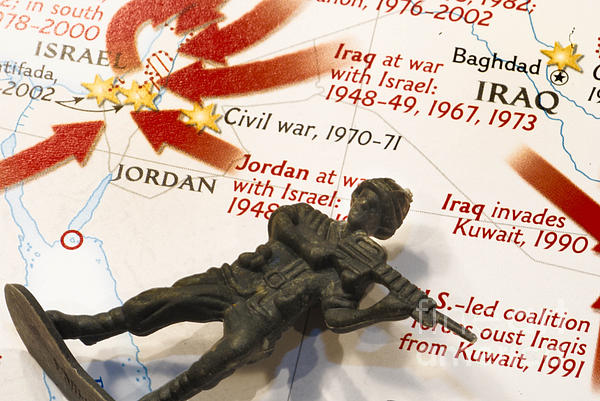 Aggression Photograph - Army Man Lying On Middle East Conflicts Map by Amy Cicconi