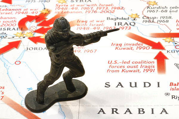 Aggression Photograph - Army Man Standing On Middle East Conflicts Map by Amy Cicconi