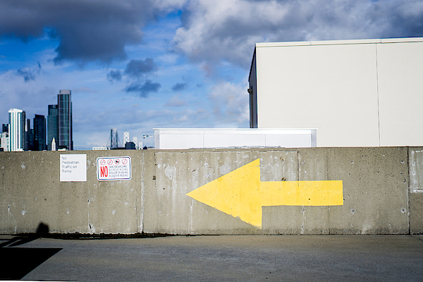 Arrow On Wall Against Sky Photograph by Jesse Coleman / EyeEm