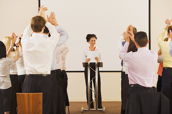 Audience Applauding Businesswoman At Podium Photograph by Jacobs Stock Photography Ltd