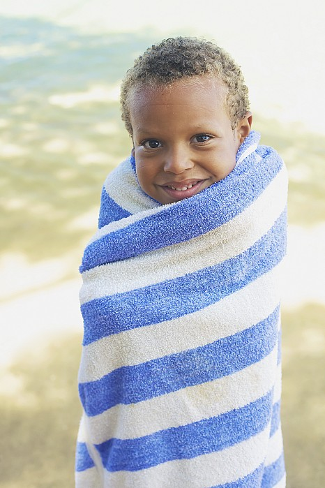 Beach Photograph - Boy In Towel by Kicka Witte