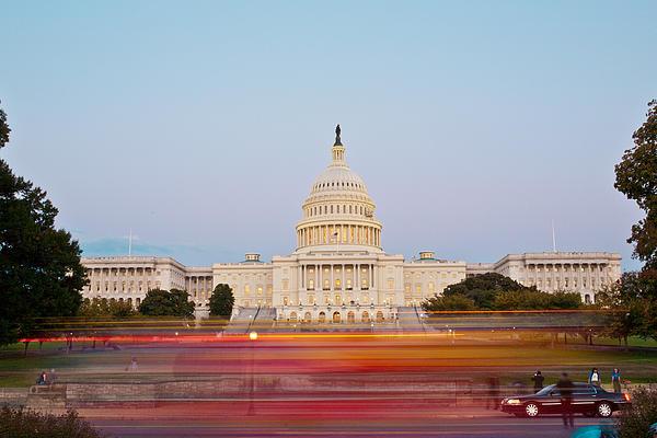 Capitol Photograph - Bus Blur And U.s.capitol Building by Richard Nowitz