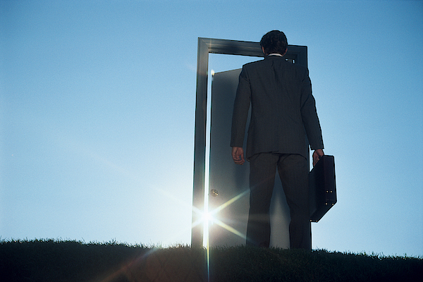 Businessman Entering Door Outdoors Photograph by Comstock