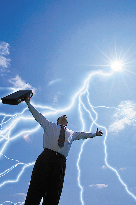 Businessman With Arms Raised And Lightning Bolts Photograph by Comstock
