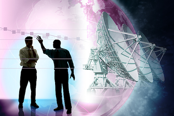 Businessmen Presenting Chart With Satellites And Globe In Background Photograph by Comstock