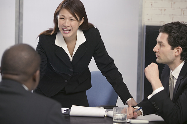 Businesspeople In A Meeting Photograph by Comstock Images