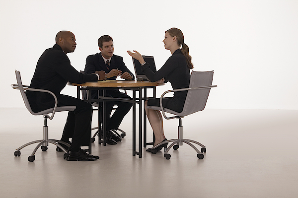 Businesspeople In Meeting Photograph by Comstock Images