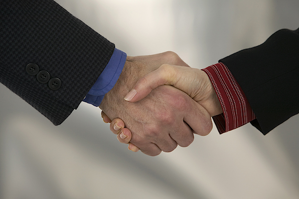 Businesspeople Shaking Hands Photograph by Comstock Images