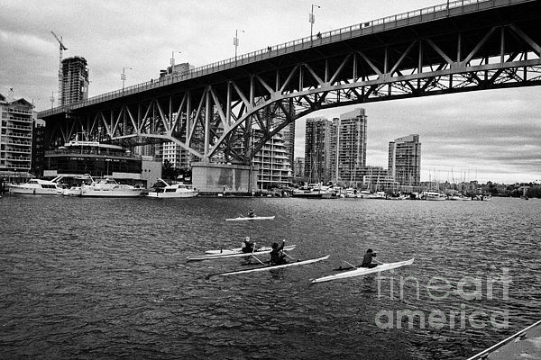 Canoe Photograph - canoeists canoeing along false creek underneath the granville bridge Vancouver BC Canada by Joe Fox