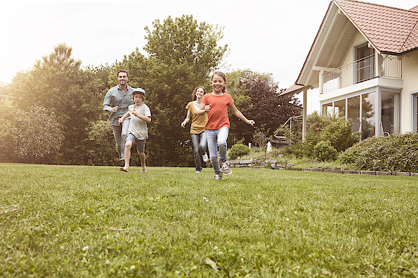 Carefree Family Running In Garden Photograph by Westend61