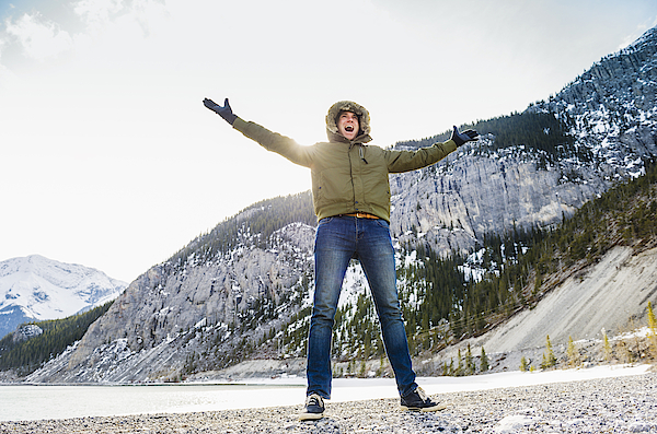 Caucasian Man Cheering In Snowy Field Photograph by Jacobs Stock Photography Ltd