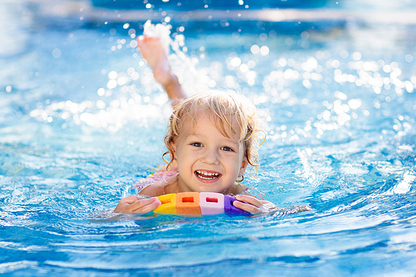 Child Learning To Swim. Kids In Swimming Pool. Photograph by FamVeld