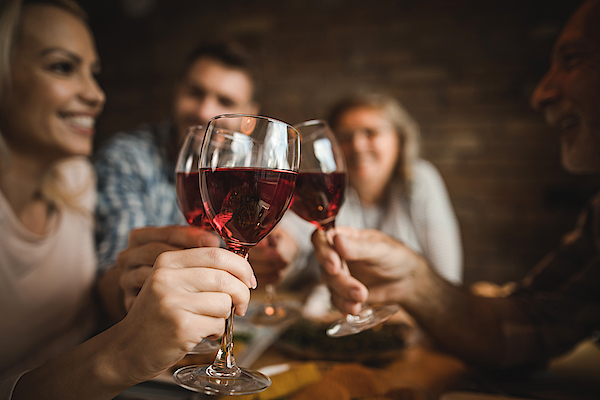 Close Up Of A Family Toasting With Red Wine At Home. Photograph by Skynesher
