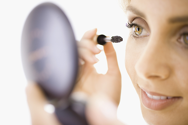 Close-up Of Woman Applying Makeup Photograph by Jupiterimages, Brand X Pictures