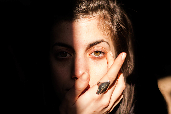 Close-up Portrait Of Young Woman Against Black Background Photograph by Phevos Theodoridis / EyeEm