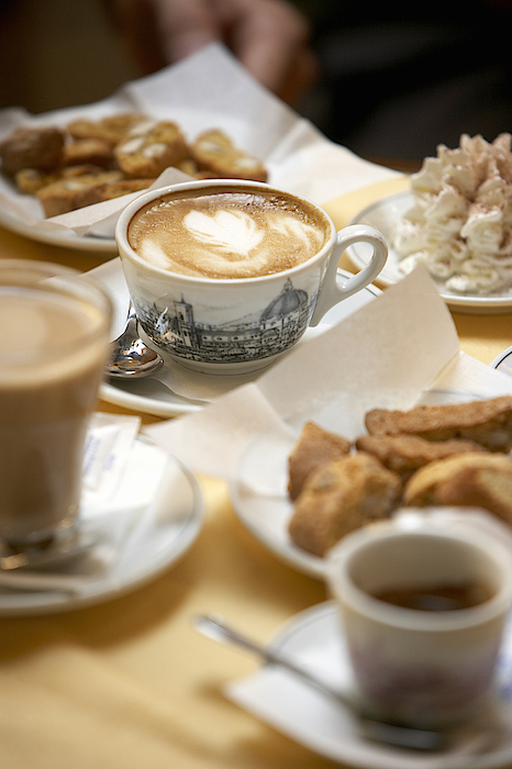Coffee Drinks And Biscotti On Table In Cafe (focus On Cappuccino) Photograph by Bob Handelman