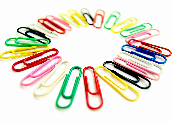 Colorful Office Clips Arranged In A Circle In A White Background Photograph by Blanchi Costela