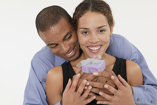 Couple Holding A Gift Photograph by Comstock Images