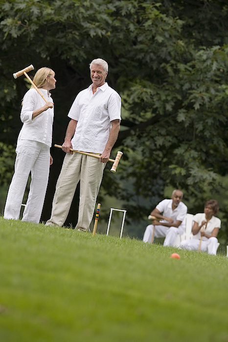 Couple Playing Croquet Photograph by Comstock Images