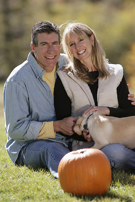 Couple With Dog Photograph by Comstock Images