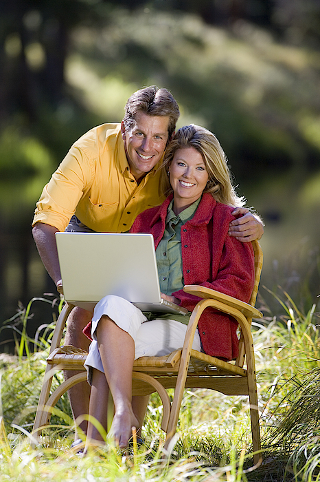 Couple With Laptop Photograph by Comstock Images