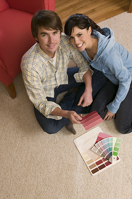 Couple With Paint Samples Photograph by Comstock Images