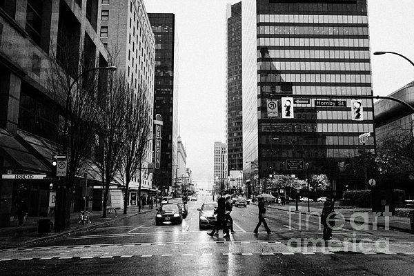 Crosswalk Photograph - crosswalk at west georgia and hornby downtown in the rain Vancouver BC Canada by Joe Fox