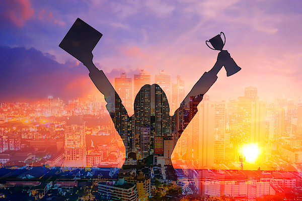 Digital Composite Image Of Woman Holding Award And Cityscape Against Sky During Sunset Photograph by Jirapatch Iamkate / EyeEm