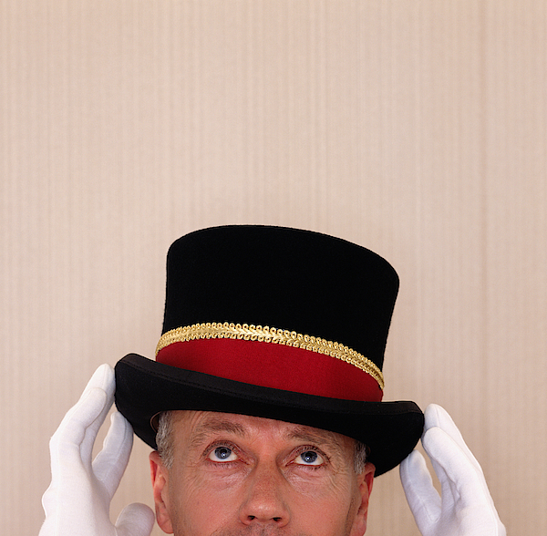 Doorman Adjusting Top Hat, High Section Photograph by Max Oppenheim